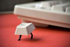 The 'Esc' (Escape) key running away from a keyboard.